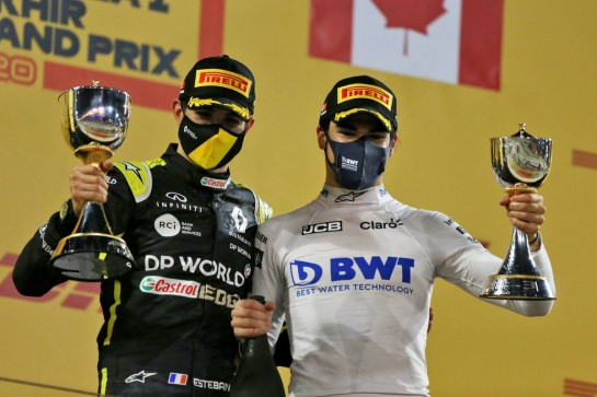 (L to R): Esteban Ocon (FRA) Renault F1 Team celebrates his second position on the podium with third placed Lance Stroll (CDN) Racing Point F1 Team. 06.12.2020. Formula 1 World Championship, Rd 16, Sakhir Grand Prix, Sakhir, Bahrain, Race Day. - www.xpbimages.com, EMail: requests@xpbimages.com © Copyright: Moy / XPB Images