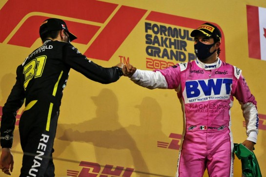 (L to R): Esteban Ocon (FRA) Renault F1 Team celebrates his second position on the podium with race winner Sergio Perez (MEX) Racing Point F1 Team. 06.12.2020. Formula 1 World Championship, Rd 16, Sakhir Grand Prix, Sakhir, Bahrain, Race Day. - www.xpbimages.com, EMail: requests@xpbimages.com © Copyright: Moy / XPB Images
