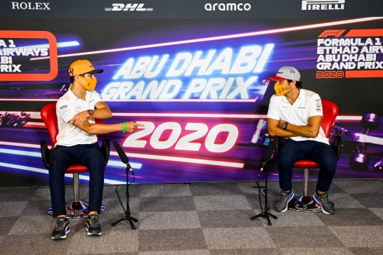(L to R): Lando Norris (GBR) McLaren with team mate Carlos Sainz Jr (ESP) McLaren in the FIA Press Conference. 10.12.2020. Formula 1 World Championship, Rd 17, Abu Dhabi Grand Prix, Yas Marina Circuit, Abu Dhabi, Preparation Day. - www.xpbimages.com, EMail: requests@xpbimages.com © Copyright: FIA Pool Image for Editorial Use Only