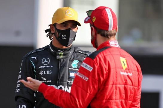 (L to R): Lewis Hamilton (GBR) Mercedes AMG F1 and Sebastian Vettel (GER) Ferrari. 13.12.2020. Formula 1 World Championship, Rd 17, Abu Dhabi Grand Prix, Yas Marina Circuit, Abu Dhabi, Race Day. - www.xpbimages.com, EMail: requests@xpbimages.com © Copyright: Moy / XPB Images