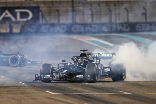 Lewis Hamilton (GBR) Mercedes AMG F1 W11 and Valtteri Bottas (FIN) Mercedes AMG F1 W11 - doughnuts at the end of the race. 13.12.2020. Formula 1 World Championship, Rd 17, Abu Dhabi Grand Prix, Yas Marina Circuit, Abu Dhabi, Race Day. - www.xpbimages.com, EMail: requests@xpbimages.com © Copyright: Charniaux / XPB Images