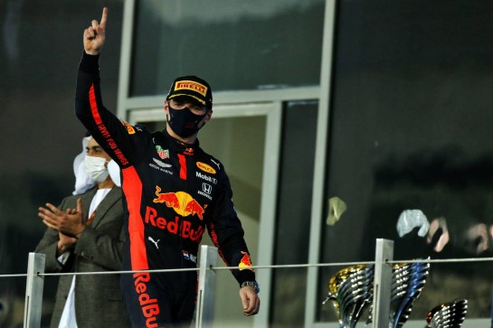 Race winner Max Verstappen (NLD) Red Bull Racing celebrates on the podium. 13.12.2020. Formula 1 World Championship, Rd 17, Abu Dhabi Grand Prix, Yas Marina Circuit, Abu Dhabi, Race Day. - www.xpbimages.com, EMail: requests@xpbimages.com © Copyright: Moy / XPB Images