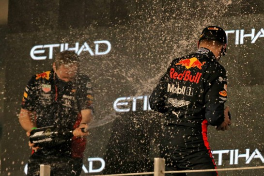 Race winner Max Verstappen (NLD) Red Bull Racing celebrates on the podium with Paul Monaghan (GBR) Red Bull Racing Chief Engineer. 13.12.2020. Formula 1 World Championship, Rd 17, Abu Dhabi Grand Prix, Yas Marina Circuit, Abu Dhabi, Race Day. - www.xpbimages.com, EMail: requests@xpbimages.com © Copyright: Moy / XPB Images
