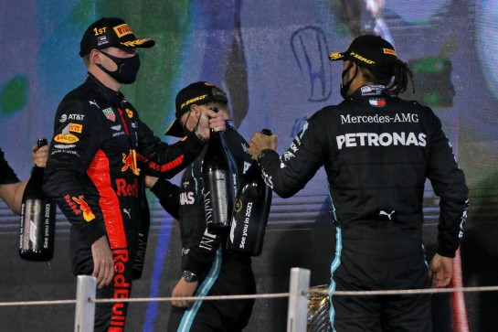 (L to R): Race winner Max Verstappen (NLD) Red Bull Racing celebrates on the podium with third placed Lewis Hamilton (GBR) Mercedes AMG F1. 13.12.2020. Formula 1 World Championship, Rd 17, Abu Dhabi Grand Prix, Yas Marina Circuit, Abu Dhabi, Race Day. - www.xpbimages.com, EMail: requests@xpbimages.com © Copyright: Moy / XPB Images