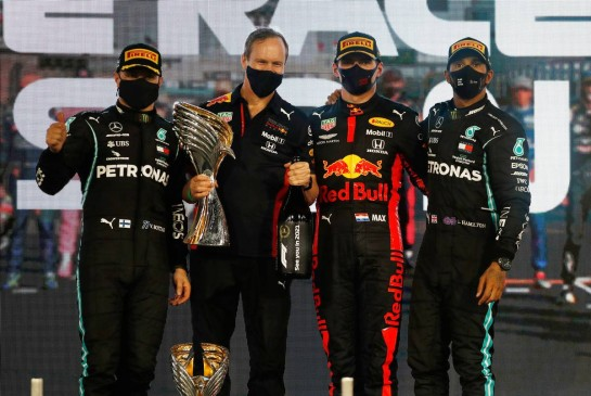 The podium (L to R): Valtteri Bottas (FIN) Mercedes AMG F1, second; Paul Monaghan (GBR) Red Bull Racing Chief Engineer; Max Verstappen (NLD) Red Bull Racing, race winner; Lewis Hamilton (GBR) Mercedes AMG F1, third. 13.12.2020. Formula 1 World Championship, Rd 17, Abu Dhabi Grand Prix, Yas Marina Circuit, Abu Dhabi, Race Day. - www.xpbimages.com, EMail: requests@xpbimages.com © Copyright: FIA Pool Image for Editorial Use Only