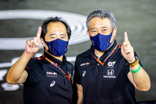 (L to R): Toyoharu Tanabe (JPN) Honda Racing F1 Technical Director and Masashi Yamamoto (JPN) Honda Racing F1 Managing Director celebrate victory for Max Verstappen (NLD) Red Bull Racing. 13.12.2020. Formula 1 World Championship, Rd 17, Abu Dhabi Grand Prix, Yas Marina Circuit, Abu Dhabi, Race Day. - www.xpbimages.com, EMail: requests@xpbimages.com © Copyright: FIA Pool Image for Editorial Use Only