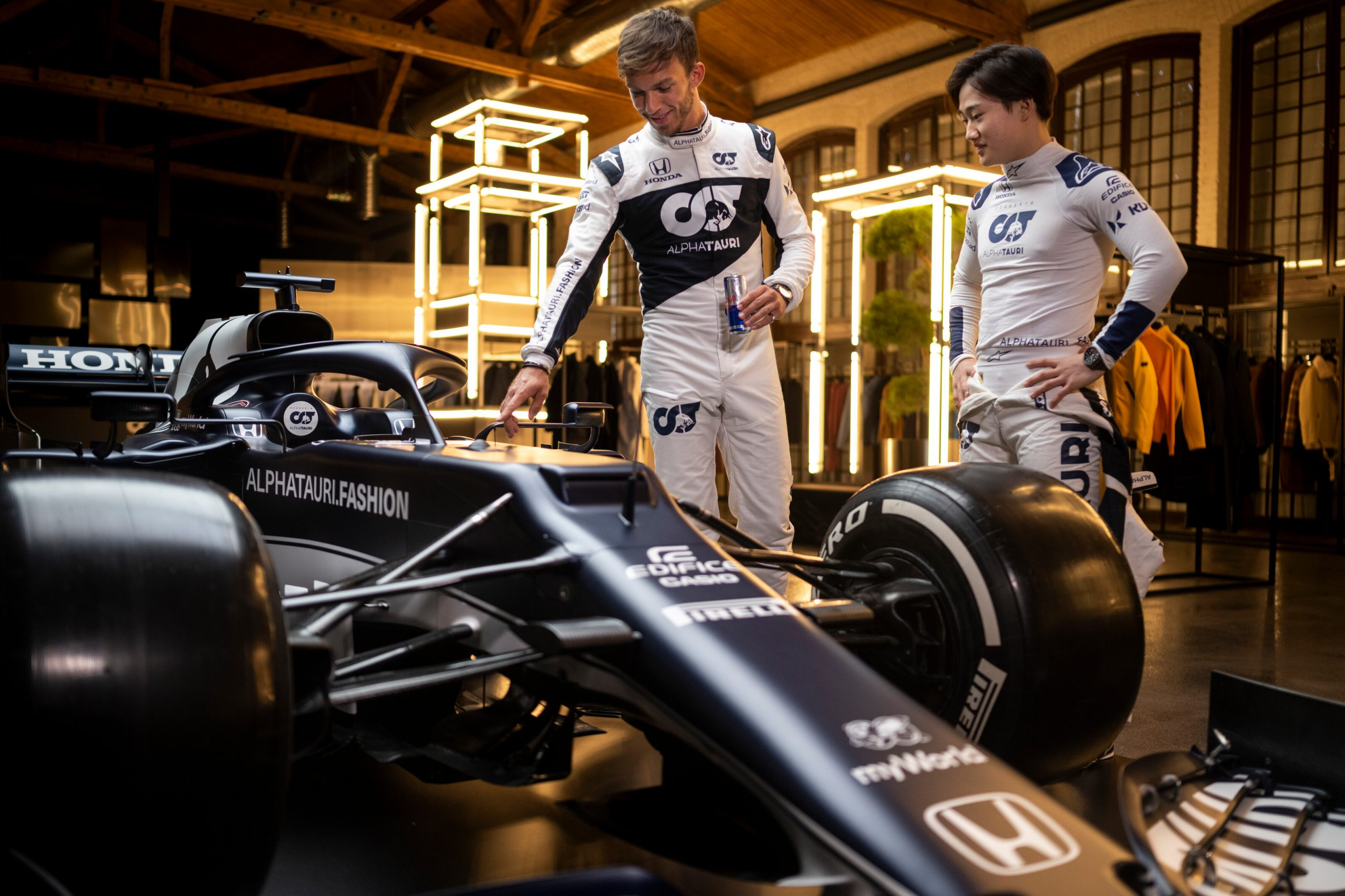 Yuki Tsunoda of Japan and Pierre Gasly of France seen during the Suderia AlphaTauri AT02 Livery Reveal 2021 - Fashion meets Formula 1 in Salzburg,
