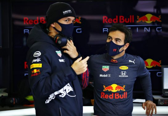 NORTHAMPTON, ENGLAND - FEBRUARY 24: Sergio Perez of Mexico and Red Bull Racing talks with Alexander Albon of Thailand and Red Bull Racing in the garage during the Red Bull Racing Filming Day at Silverstone on February 24, 2021 in Northampton, England. (Photo by Mark Thompson/Getty Images for Red Bull Racing) // Getty Images / Red Bull Content Pool  // SI202102240150 // Usage for editorial use only //