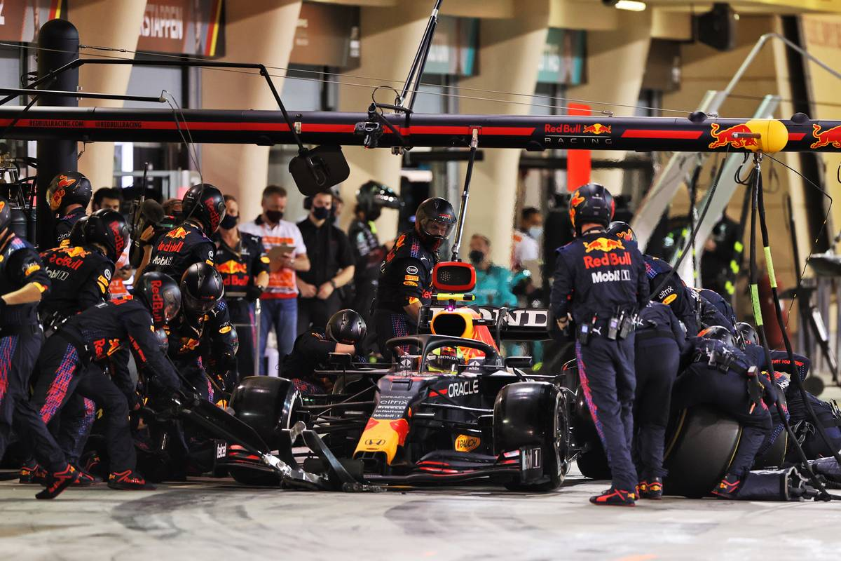Sergio Perez (MEX) Red Bull Racing RB16B makes a pit stop. 28.03.2021. Formula 1 World Championship, Rd 1, Bahrain Grand Prix