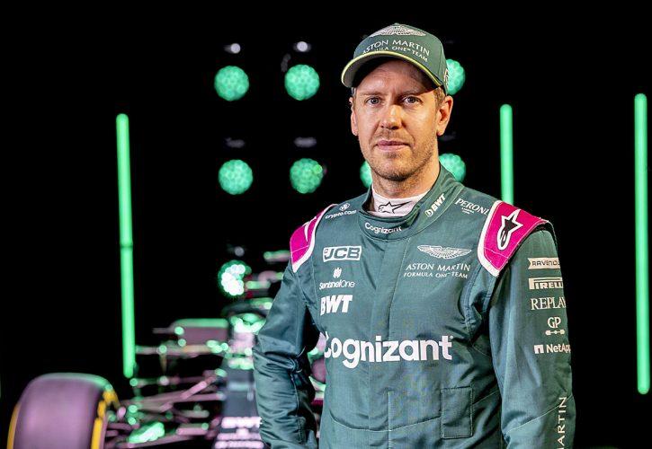 Sebastian Vettel, Aston Martin, in front of the AMR21.