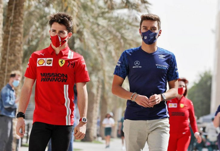 Charles Leclerc (MON) Ferrari with George Russell (GBR) Williams Racing.