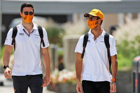 Daniel Ricciardo (AUS) McLaren with Michael Italiano (AUS) McLaren Performance Coach. 26.03.2021. Formula 1 World Championship, Rd 1, Bahrain Grand Prix, Sakhir, Bahrain, Practice Day - www.xpbimages.com, EMail: requests@xpbimages.com © Copyright: Moy / XPB Images