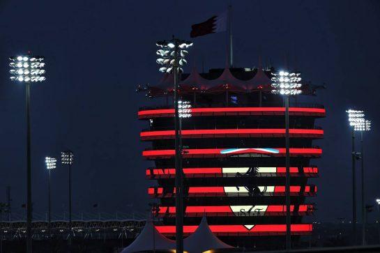 Circuit atmosphere - illuminated building - Ferrari. 26.03.2021. Formula 1 World Championship, Rd 1, Bahrain Grand Prix, Sakhir, Bahrain, Practice Day - www.xpbimages.com, EMail: requests@xpbimages.com © Copyright: Batchelor / XPB Images