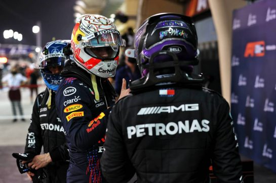 Max Verstappen (NLD) Red Bull Racing and Lewis Hamilton (GBR) Mercedes AMG F1 in qualifying parc ferme.