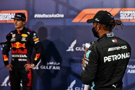 Lewis Hamilton (GBR) Mercedes AMG F1 and Max Verstappen (NLD) Red Bull Racing in qualifying parc ferme.