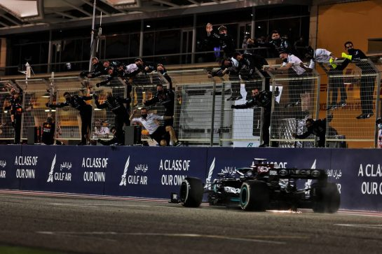 Race winner Lewis Hamilton (GBR) Mercedes AMG F1 W12 passes his celebrating team at the end of the race. 28.03.2021. Formula 1 World Championship, Rd 1, Bahrain Grand Prix, Sakhir, Bahrain, Race Day. - www.xpbimages.com, EMail: requests@xpbimages.com © Copyright: Batchelor / XPB Images