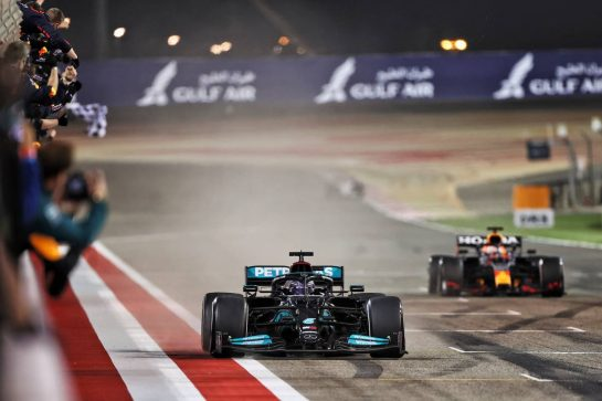 Race winner Lewis Hamilton (GBR) Mercedes AMG F1 W12 takes the chequered flag at the end of the race ahead of second placed Max Verstappen (NLD) Red Bull Racing RB16B. 28.03.2021. Formula 1 World Championship, Rd 1, Bahrain Grand Prix, Sakhir, Bahrain, Race Day. - www.xpbimages.com, EMail: requests@xpbimages.com © Copyright: Moy / XPB Images