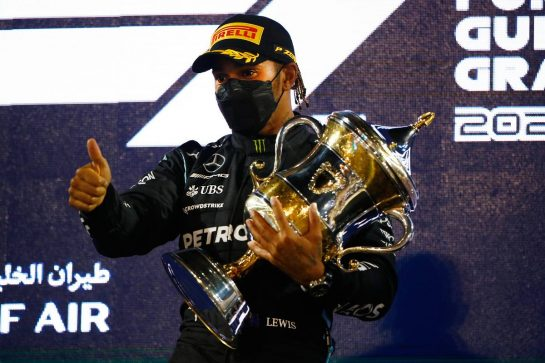 Race winner Lewis Hamilton (GBR) Mercedes AMG F1 celebrates on the podium. 28.03.2021. Formula 1 World Championship, Rd 1, Bahrain Grand Prix, Sakhir, Bahrain, Race Day. - www.xpbimages.com, EMail: requests@xpbimages.com © Copyright: FIA Pool Image for Editorial Use Only