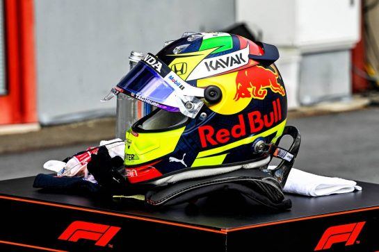 The helmet of Sergio Perez (MEX) Red Bull Racing in qualifying parc ferme. 17.04.2021. Formula 1 World Championship, Rd 2, Emilia Romagna Grand Prix, Imola, Italy, Qualifying Day. - www.xpbimages.com, EMail: requests@xpbimages.com © Copyright: FIA Pool Image for Editorial Use Only