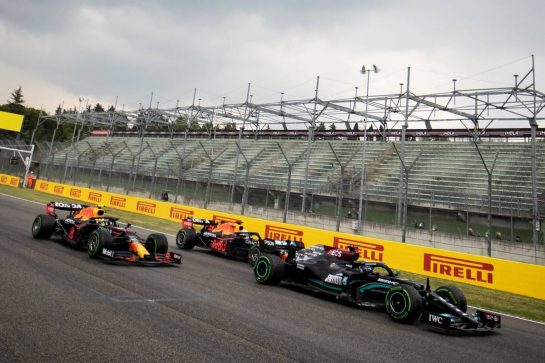 Lewis Hamilton (GBR) Mercedes AMG F1 W12 leads Sergio Perez (MEX) Red Bull Racing RB16B and Max Verstappen (NLD) Red Bull Racing RB16B at the start of the race. 18.04.2021. Formula 1 World Championship, Rd 2, Emilia Romagna Grand Prix, Imola, Italy, Race Day. - www.xpbimages.com, EMail: requests@xpbimages.com © Copyright: Bearne / XPB Images
