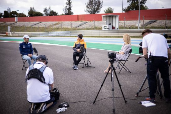 (L to R): George Russell (GBR) Williams Racing and Lando Norris (GBR) McLaren with Rachel Brookes (GBR) Sky Sports F1 Reporter.