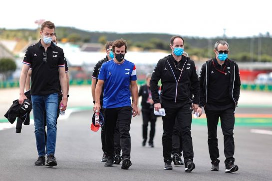 (L to R): Daniil Kvyat (RUS) Alpine F1 Team Reserve Driver and Fernando Alonso (ESP) Alpine F1 Team walks the circuit with the team.