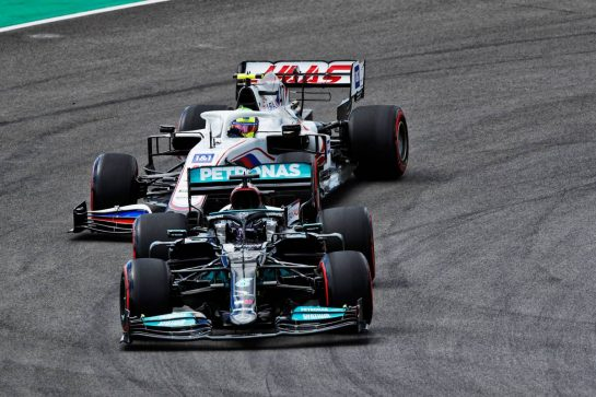Lewis Hamilton (GBR) Mercedes AMG F1 W12 leads Mick Schumacher (GER) Haas VF-21.