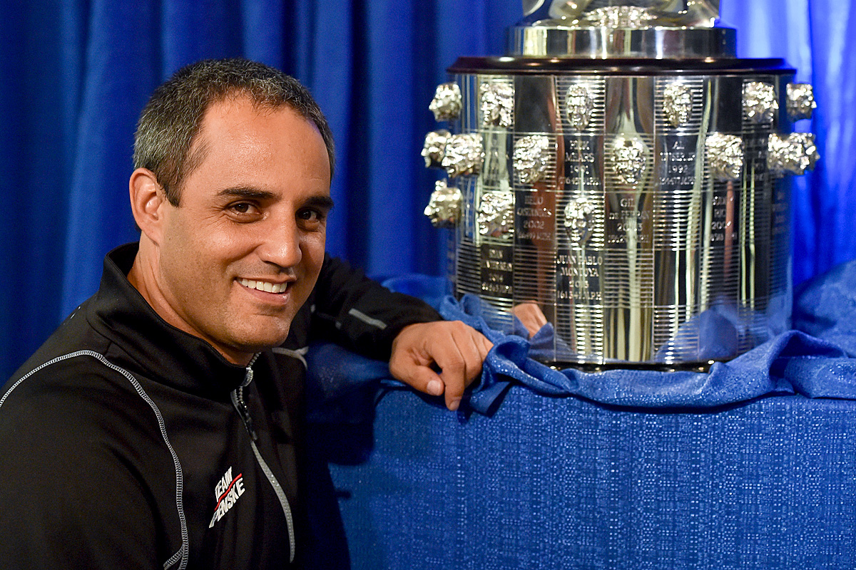 2015 Indy 500 winner Juan Pablo Montoya points to his face on the Borg-Warner trophy (Photo by: IndyCar Media)