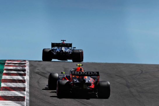 Lewis Hamilton (GBR) Mercedes AMG F1 W12 leads Sergio Perez (MEX) Red Bull Racing RB16B. 01.05.2021. Formula 1 World Championship, Rd 3, Portuguese Grand Prix, Portimao, Portugal, Qualifying Day.  - www.xpbimages.com, EMail: requests@xpbimages.com © Copyright: Staley / XPB Images