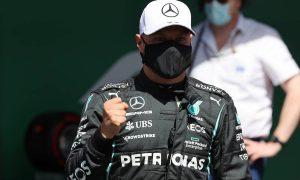Bottas takes pole by seven thousandths from Hamilton