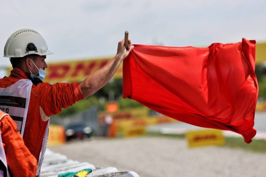 Circuit atmosphere - a marshal waves a red flag in the first practice session. 07.05.2021 Formula 1 World Championship, Rd 4, Spanish Grand Prix, Barcelona, Spain, Practice Day. - www.xpbimages.com, EMail: requests@xpbimages.com © Copyright: Batchelor / XPB Images