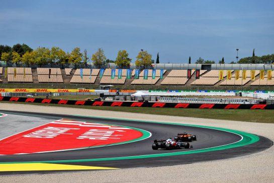 Lando Norris (GBR) McLaren MCL35M leads Kimi Raikkonen (FIN) Alfa Romeo Racing C41. 08.05.2021. Formula 1 World Championship, Rd 4, Spanish Grand Prix, Barcelona, Spain, Qualifying Day. - www.xpbimages.com, EMail: requests@xpbimages.com © Copyright: Moy / XPB Images