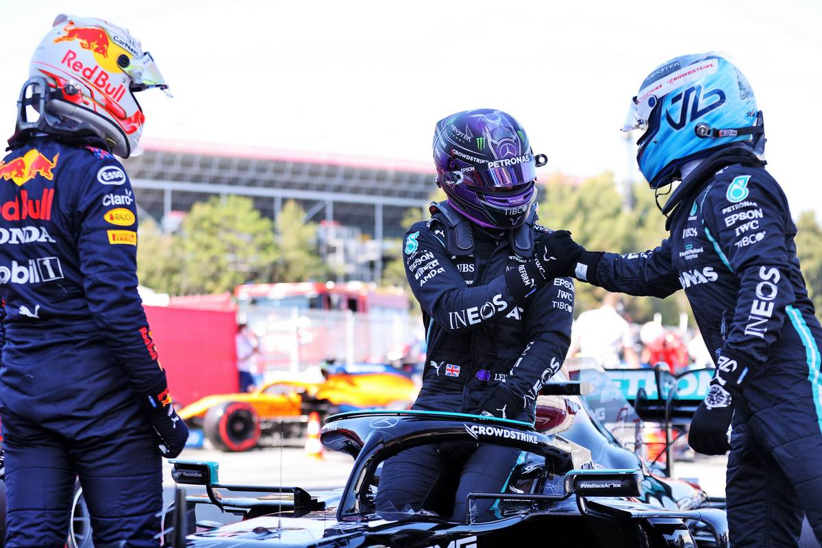 Lewis Hamilton (GBR) Mercedes AMG F1 W12 (Centre) celebrates his 100th pole position in qualifying parc ferme with team mate Valtteri Bottas (FIN) Mercedes AMG F1 (Right) and Max Verstappen (NLD) Red Bull Racing (Left). 08.05.2021. Formula 1 World Championship, Rd 4, Spanish Grand Prix, Barcelona