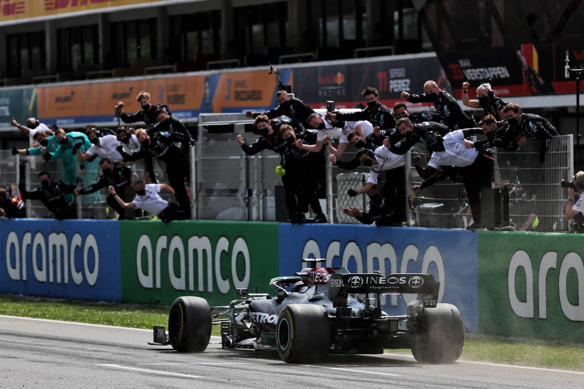 Race winner Lewis Hamilton (GBR) Mercedes AMG F1 W12 passes his celebrating team at the end of the race. 09.05.2021. Formula 1 World Championship, Rd 4, Spanish Grand Prix, Barcelona