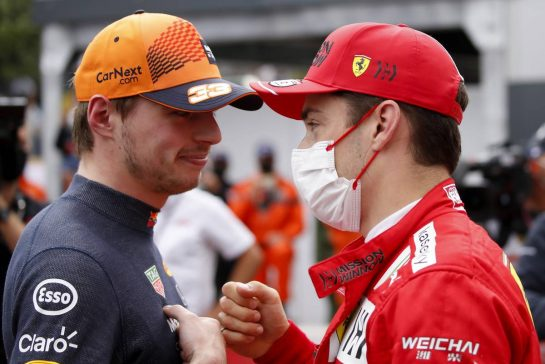 Charles Leclerc (MON) Ferrari (Right) celebrates his pole position in qualifying parc ferme with second placed Max Verstappen (NLD) Red Bull Racing. 22.05.2021. Formula 1 World Championship, Rd 5, Monaco Grand Prix, Monte Carlo, Monaco, Qualifying Day. - www.xpbimages.com, EMail: requests@xpbimages.com © Copyright: FIA Pool Image for Editorial Use Only