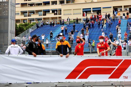 (L to R): Lewis Hamilton (GBR) Mercedes AMG F1; Daniel Ricciardo (AUS) McLaren; and Charles Leclerc (MON) Ferrari on the drivers parade. 23.05.2021. Formula 1 World Championship, Rd 5, Monaco Grand Prix, Monte Carlo, Monaco, Race Day. - www.xpbimages.com, EMail: requests@xpbimages.com © Copyright: Batchelor / XPB Images