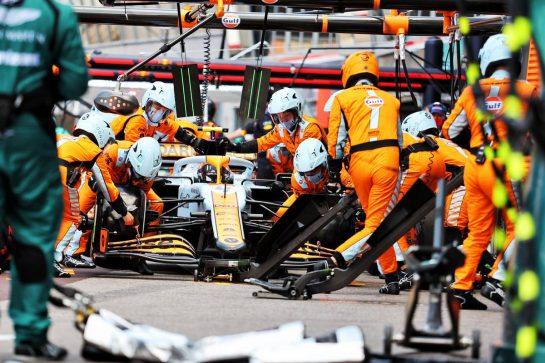 Lando Norris (GBR) McLaren MCL35M makes a pit stop. 23.05.2021. Formula 1 World Championship, Rd 5, Monaco Grand Prix, Monte Carlo, Monaco, Race Day. - www.xpbimages.com, EMail: requests@xpbimages.com © Copyright: Charniaux / XPB Images