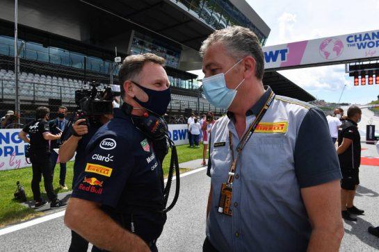 (L to R): Christian Horner (GBR) Red Bull Racing Team Principal with Mario Isola (ITA) Pirelli Racing Manager on the grid. 27.06.2021. Formula 1 World Championship, Rd 8, Steiermark Grand Prix, Spielberg, Austria, Race Day. - www.xpbimages.com, EMail: requests@xpbimages.com © Copyright: FIA Pool Image for Editorial Use Only