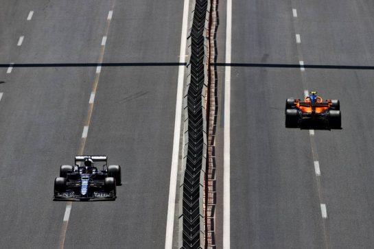 Yuki Tsunoda (JPN) AlphaTauri AT02 and Lando Norris (GBR) McLaren MCL35M. 05.06.2021. Formula 1 World Championship, Rd 6, Azerbaijan Grand Prix, Baku Street Circuit, Azerbaijan, Qualifying Day. - www.xpbimages.com, EMail: requests@xpbimages.com © Copyright: Moy / XPB Images
