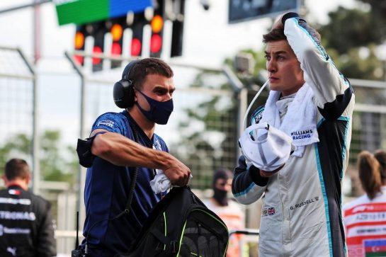George Russell (GBR) Williams Racing with Aleix Casanovas, Williams Racing Personal Trainer in the pits while the race is stopped. 06.06.2021. Formula 1 World Championship, Rd 6, Azerbaijan Grand Prix, Baku Street Circuit, Azerbaijan, Race Day. - www.xpbimages.com, EMail: requests@xpbimages.com © Copyright: Charniaux / XPB Images
