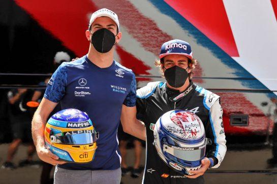 (L to R): Nicholas Latifi (CDN) Williams Racing with Fernando Alonso (ESP) Alpine F1 Team - helmet swap. 24.06.2021. Formula 1 World Championship, Rd 8, Steiermark Grand Prix, Spielberg, Austria, Preparation Day. - www.xpbimages.com, EMail: requests@xpbimages.com © Copyright: Moy / XPB Images
