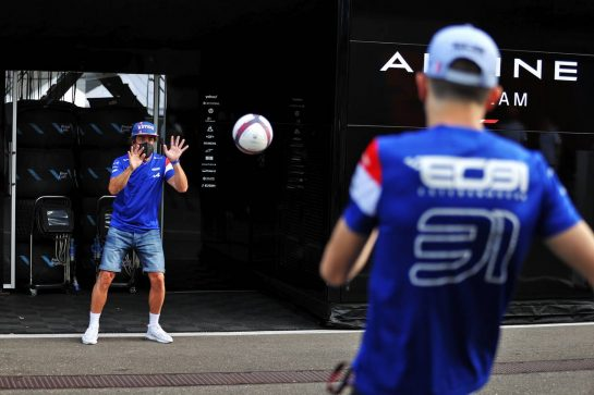 Fernando Alonso (ESP) Alpine F1 Team plays football in the paddock with team mate Esteban Ocon (FRA) Alpine F1 Team. 24.06.2021. Formula 1 World Championship, Rd 8, Steiermark Grand Prix, Spielberg, Austria, Preparation Day. - www.xpbimages.com, EMail: requests@xpbimages.com © Copyright: Moy / XPB Images