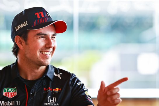 SPIELBERG, AUSTRIA - JULY 01: Sergio Perez of Mexico and Red Bull Racing talks in the Paddock during previews ahead of the F1 Grand Prix of Austria at Red Bull Ring on July 01, 2021 in Spielberg, Austria. (Photo by Mark Thompson/Getty Images) // Getty Images / Red Bull Content Pool  // SI202107010155 // Usage for editorial use only //