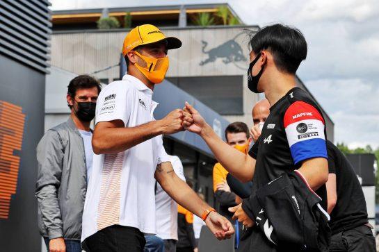 (L to R): Daniel Ricciardo (AUS) McLaren with Guanyu Zhou (CHN) Alpine F1 Team Test Driver. 01.07.2021. Formula 1 World Championship, Rd 9, Austrian Grand Prix, Spielberg, Austria, Preparation Day. - www.xpbimages.com, EMail: requests@xpbimages.com © Copyright: Moy / XPB Images