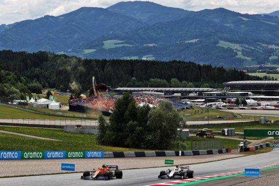 Lando Norris (GBR) McLaren MCL35M and Mick Schumacher (GER) Haas VF-21. 02.07.2021. Formula 1 World Championship, Rd 9, Austrian Grand Prix, Spielberg, Austria, Practice Day. - www.xpbimages.com, EMail: requests@xpbimages.com © Copyright: Batchelor / XPB Images