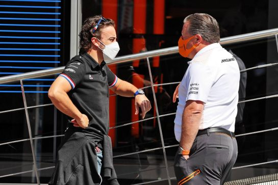 (L to R): Fernando Alonso (ESP) Alpine F1 Team with Zak Brown (USA) McLaren Executive Director. 03.07.2021. Formula 1 World Championship, Rd 9, Austrian Grand Prix, Spielberg, Austria, Qualifying Day. - www.xpbimages.com, EMail: requests@xpbimages.com © Copyright: Moy / XPB Images
