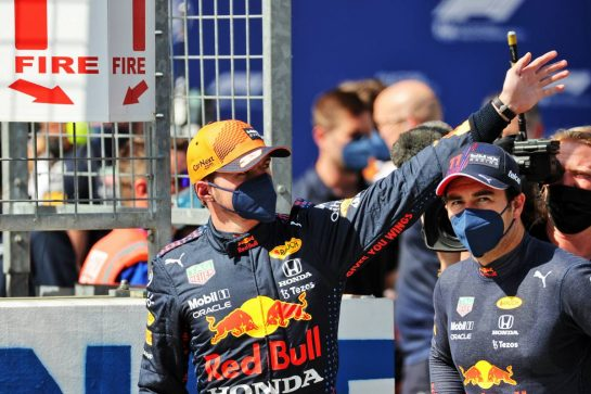 (L to R): Max Verstappen (NLD) Red Bull Racing celebrates his pole position in qualifying parc ferme with third placed team mate Sergio Perez (MEX) Red Bull Racing. 03.07.2021. Formula 1 World Championship, Rd 9, Austrian Grand Prix, Spielberg, Austria, Qualifying Day. - www.xpbimages.com, EMail: requests@xpbimages.com © Copyright: Batchelor / XPB Images
