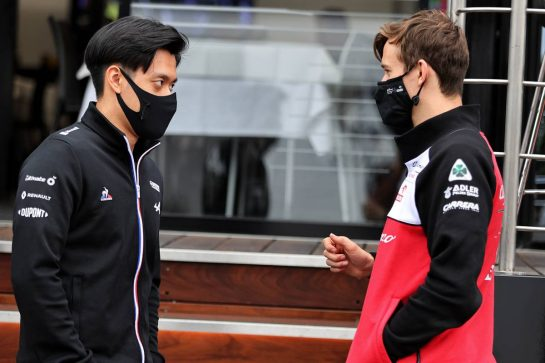 (L to R): Guanyu Zhou (CHN) Alpine F1 Team Test Driver with Callum Ilott (GBR) Alfa Romeo Racing Reserve Driver. 04.07.2021. Formula 1 World Championship, Rd 9, Austrian Grand Prix, Spielberg, Austria, Race Day. - www.xpbimages.com, EMail: requests@xpbimages.com © Copyright: Moy / XPB Images