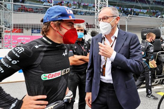 (L to R): Fernando Alonso (ESP) Alpine F1 Team with Stefano Domenicali (ITA) Formula One President and CEO on the grid. 04.07.2021. Formula 1 World Championship, Rd 9, Austrian Grand Prix, Spielberg, Austria, Race Day. - www.xpbimages.com, EMail: requests@xpbimages.com © Copyright: Moy / XPB Images