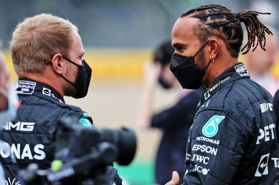 (L to R): Valtteri Bottas (FIN) Mercedes AMG F1 with team mate Lewis Hamilton (GBR) Mercedes AMG F1 - 2022 Car Launch. 15.07.2021. Formula 1 World Championship, Rd 10, British Grand Prix, Silverstone, England, Preparation Day. - www.xpbimages.com, EMail: requests@xpbimages.com © Copyright: Batchelor / XPB Images